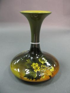 Rookwood high glaze vase with floral decoration signed Rookwood 715D, artist signed MLP. Being sold to benefit The Holley-Williams House Museum of Lakeville, Connecticut.