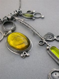 green olive green acid green oxidized sterling silver charm necklace pendants vintage glass metalsmith contemporary modern jewelry