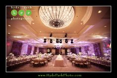 The large crystal chandeliers were the focus for this winter wedding reception at the Four Seasons Hotel in Downtown Austin, TX. Photo by Austin wedding photographers, Hyde Park Photography. www.HydeParkPhotography.com