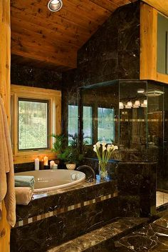 Master bathroom uses a combination of marble and white cedar for finishes.