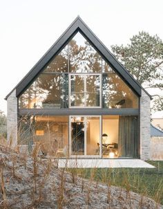 This holiday home situated by the dunes of the Wadden Sea on the Eiderstedt peninsula blends in perfectly with its surroundings: The colours of the beach can be found in the stone façade, in the slate-gray wooden wind. Hostels, Stone Facade, The Dunes, My Dream Home, Home Interior Design, My House, Architecture Design, Beautiful Places, Sweet Home
