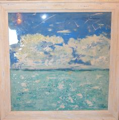 """Sharon Kator's gorgeous mixed media seascape will not be here for long! It is framed in a lovely wooden distressed ivory wash frame and measures 29"""" x 29"""". Stop by Cerulean Interiors to see it in person!"""