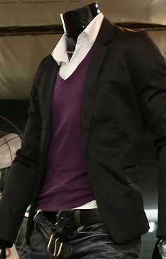 Purple v neck sweater, white dress shirt, black blazer, dark jeans. Good look for going from campus to going out
