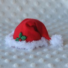 Mini Santa Hat Christmas Hair Clip in Red and White with Green Sparkle Holly. $11.00, via Etsy.