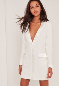 For boss babe vibes, this blazer dress in a versatile white hue, contrast satin trim and pocket deets is a sleek all-rounder.