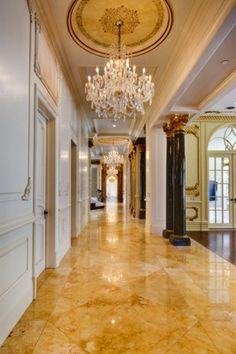 54 Beverly Park | Crystal chandeliers line the extended hallway.