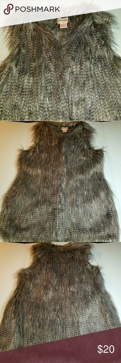 """Vest, Faux Fur, XL Toffee Apple faux fur vest in shades of grey, medium brown, and soft white.  Size XL.  Front slant pockets with hook clasp at mid-chest.  32"""" in length from collar to hem.  Machine washable.  This is so adorable with leggings and booties!  Excellent condition as I've worn it twice.  It's too big for me now so snatch this beauty up to grace your closet! Toffee Apple Jackets & Coats Vests"""