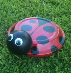 "Terra Cotta Lady Bug: Picture Take a 6 1/2"" Terra Cotta Saucer and coat the top of the saucer with Deco Arts Red Patio Paint and the underside with Black. Let paint dry."