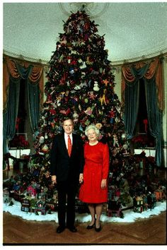 President and Mrs. George HW Bush in front of the White House Christmas Tree, December