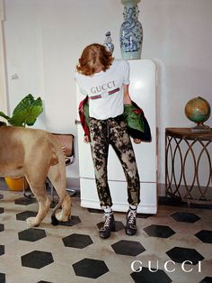 The Gucci Spring Summer 2017 campaign, filmed in Rome, featuring a t-shirt with reworked house logo from the 80s, bleached denim pants and brogue boots with a studded tiger head buckle.