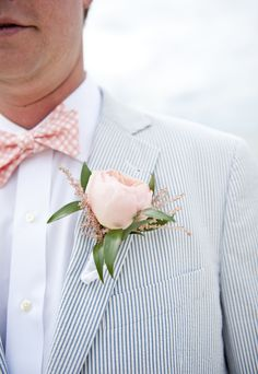 Striped seersucker suit with a pink bow tie + bloom - photo by Jen Harvey Photography  - to see more: http://www.theperfectpalette.com/2014/03/real-wedding-matt-and-sally.html