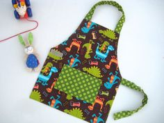 I think I may have already pinned this one but we received the apron yesterday...it is ADORABLE and very high quality with elastic and velcro to make it easy for our kids to take it on and off...well done! (Montessori Child Apron boys DINOSAURS 36yrs by zuckerbohne on Etsy, $22.00)