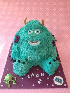 My Sully from Monsters Inc cake! Chocolate sponge with vanilla piped 'fur' and mini handmade and edible Mike Wozowski! This cake was huge! x http://www.facebook.com/clarescupcakery