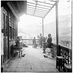Balcony of a tea house (茶樓), probably Heng Fa Lau (杏花樓) in the Chinese Quarter of the Victoria City, Hong Kong, taken by famous photo journalist John Thomson during his stay in between 1868 – 71