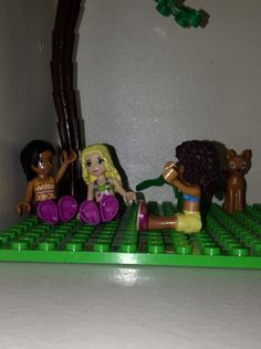 Lego Friends Andrea, Joanna Isabelle, and Fawn at night.