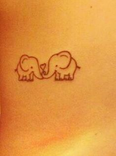 big elephant and little elephant... big sis and little sis? @Hannah Mestel Freden :) on our ribs