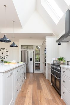 White Family Kitchen-The layout flows so well here. Food provisions are all toge… – Pantry With One Redo White Wood Kitchens, Cool Kitchens, Fisher And Paykel Fridge, Pantry Cupboard, Handmade Kitchens, Kitchen Worktop, Bespoke Kitchens, Family Kitchen, Kitchen Cabinet Design