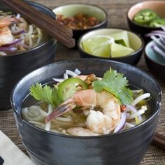 A Vietnamese classic soup, this Shrimp pho has rice noodles in a scented broth, topped with stir-fried shrimp and traditional toppings.