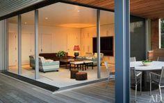 A geometric Hamptons house by Leroy Street Studio and decorator Thad Hayes Design-cabana-room.jpg