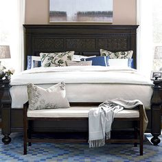 Featuring a paneled design and turned finial posts, this timeless bed adds a stately touch to your guest room or master suite.  Product: BedConstruction Material: Poplar wood veneers and hardwood solidsColor: Molasses