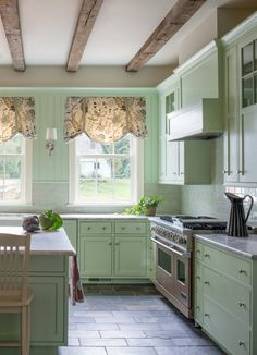 pale green kitchen farmhouse with ewer transitional dining room tables Modern Kitchen Cabinets, Home Kitchens, Transitional Dining Room Table, Contemporary Kitchen, Kitchen Cabinet Design, Kitchen Decor, Small Kitchen, Farmhouse Kitchen Design, Green Kitchen Cabinets