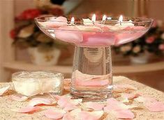 Floating Candles | Floating candles and rose petals drift delicately in these modern ...