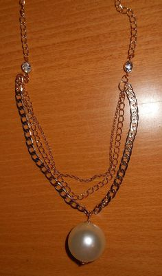 Gold tone multilayer necklace with a huge pearl bead