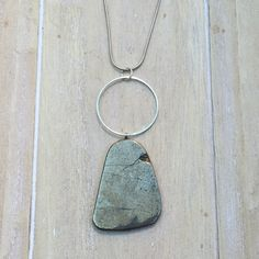 Silver colored snake chain necklace with pyrite by MadeByLeave