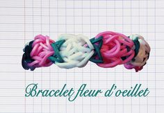 Le bracelet Fleurs d'Oeillets Suivez les explicationsen vidéodeRainbow Loom Creativepour savoir comment réaliserle bracelet Fleurs d'oeillets, un modèle floral niveau avancé fait avec des élastiques Rainbow Loom, à faire avec les couleurs de votre choix.