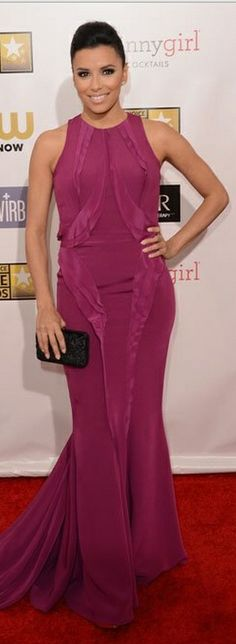 Who made Eva Longoria's black clutch handbag and pink ruffle gown that she wore to the 2013 Critics' Choice Awards? Dress – Monique Lhuillier  Purse – Ferragamo