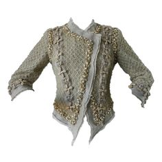 Linen jacket embellished with raffia, pearls, and Swarovski crystals covered in silk lace net | Karl Lagerfeld for Chanel | France, Spring/Summer 2010 collection