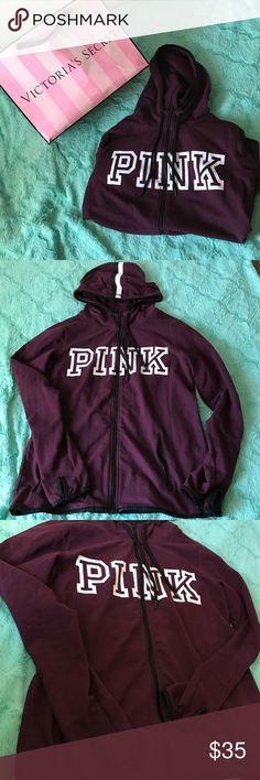 PINK burgundy hoodie PINK burgundy zip up hoodie; Size Large; has PINK label written across chest in white; has thumbs holes to put your thumbs through; very light soft and comfortable; has drawstrings for the hoodie; zip up pockets; perfect to match with any other PINK clothing outfit PINK Victoria's Secret Other
