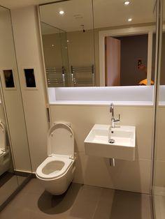 Bathroom fitting in South West London - a big mirror