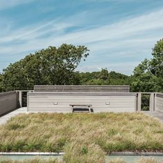 Landscape architects Reed Hilderbrand helped fill out the completed prefab by planting sedge grass on one of the house's two green roofs to reflect the texture of the surrounding meadow. Photo by: Matthew Williams Landscape Architecture, Landscape Design, Pavilion Architecture, Architecture Design, Sustainable Architecture, Residential Architecture, Contemporary Architecture, Environmental Architecture, Garden Design