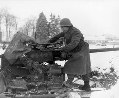 Private Paul Romanick of Battery B Anti-aircraft Artillery Battalion US Infantry Division cleaning anti-aircraft gun Sourbrodt Belgium 31 December Note 6 swastika symbols representing 6 kills. Battle Fight, History Online, Ardennes, Army Vehicles, Prisoners Of War, American Soldiers, Military History, Us Army, World War Two