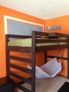 Loft bed with a little storage table built on the side (and a hammock - haha)