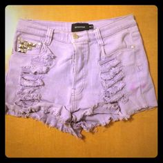 High waisted purple shorts Destroyed denim stretchy fabric with studs slight stain from washer that can be dry cleaned MinkPink Jeans