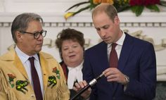 Grand Chief Stewart Philip looks on as the Duke of Cambridge places a Ring of Reconciliation upon the Black Rod during a small ceremony in Victoria, B.C., Monday, Sept 26, 2016.
