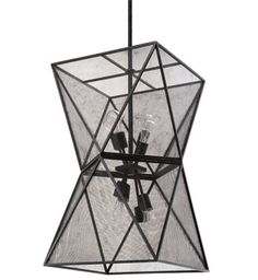 Metal and mesh twist around a cluster of exposed bulbs to create the Isosceles chandelier by Regina Andrew, creating a dramatic modern silhouette.