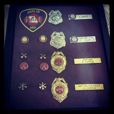 My husband retired from the fire department. I took his badges, collar brass, name tags, & patches & made him this shadowbox of firefighting.