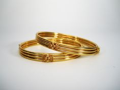pair of traditional gold bangles in kada pattern Kids Gold Jewellery, Gold Jewellery Design, Gold Jewelry, Jewellery Earrings, Bridal Jewellery, Gold Necklaces, Gold Bracelets, Chain Jewelry, Gold Bangles Design