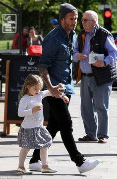 Daddy's girl: David Beckham enjoyed a day out with three-year-old daughter Harper in north London on Tuesday
