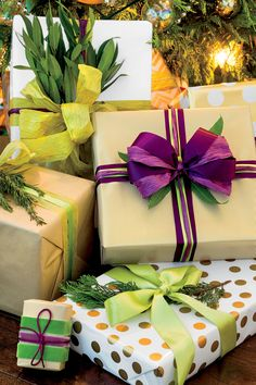 25 Stylish Christmas Gift Wrapping Ideas - Newly house proud, Kristin Gish of Austin, Texas, wraps her gifts with paper that match her living r. - By the Editors of Southern Living Christmas Gift Wrapping, Christmas Presents, Holiday Gifts, Holiday Ideas, Holiday Decor, Christmas Colors, Kids Christmas, Christmas Decorations, Christmas Trees