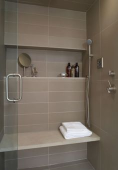 Ensuite tiles, also recessed shelf in shower