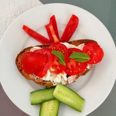 Healthy Living - day2 - lunch/afternoon snack Trader joes  light cream cheese, sliced tomatoes, cucumber, sweet red pepper, %100 toasted wheat bread , feta cheese, organic, yummmm!