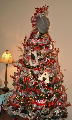 The traditional Bama tree. Lots of houndstooth ribbon, silver deco mesh, and red wired ribbon.