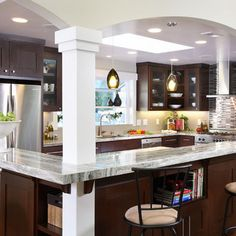 Love the way the columns are integrated with the countertops.