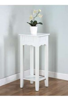 www.handhelditems.com304 × 450Search by image Color Story Crimson Red Plant Stand With Bottom Shelf