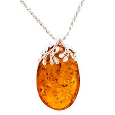 "A stunning piece of handmade jewellery, featuring cognac Baltic amber with a sterling silver leaf design. The pendant is on a sterling silver cord chain with extender and claw bail.  Dimensions: Width: 2.3 cm L: 4 cm Chain: 16""-18""/41-46 cm All our silver is assayed and hallmarked.  These stones are hand cut Baltic Amber. Each piece of jewellery is individually crafted so shapes, sizes, markings and colour may vary."