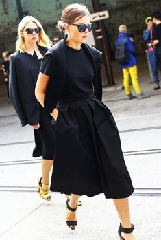 Le Fashion Blog Street Style All Black Ladylike Minimal Spring Look Australia Fashion Week Sydney Style Low Bun Cat Eye Sunglasses Sweater Over Shoulders Classic Black Tee T-shirt Full Skirt Culottes Gaucho Style cropped Wide Leg Pants Ankle Strap Sandals Via Vogue photo Le-Fashion-Blog-Street-Style-All-Black-Ladylike-Minimal-Spring-Look-Australia-Fashion-Week-Via-Vogue.jpg